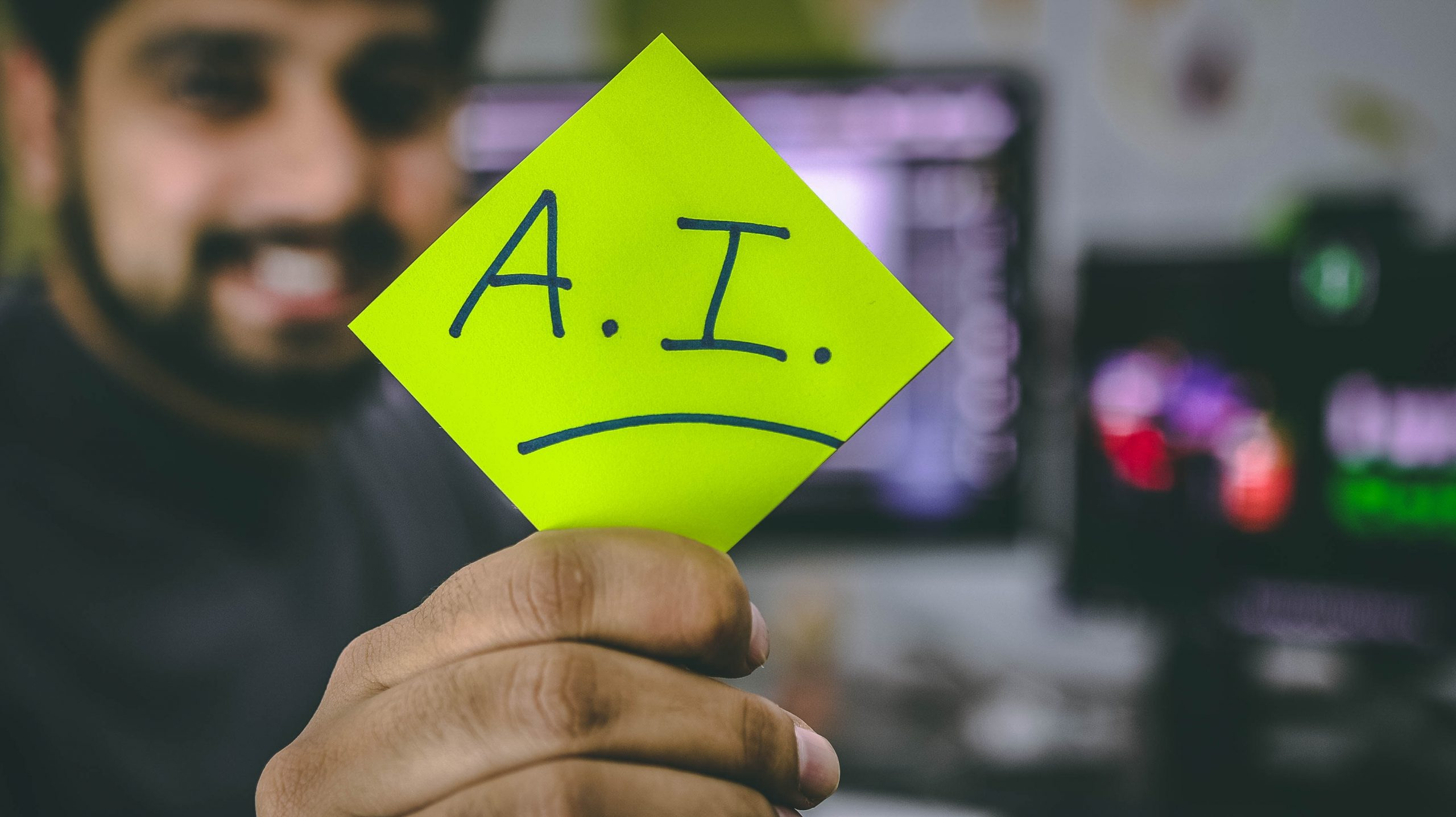 A person holding an A.I posits note. Artificial Intelligence is here.